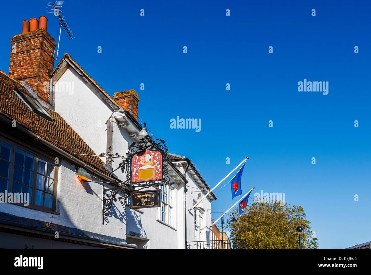 Sign at the historic 15th century Woolpack Hotel in High Street, Tenterden, Kent, southeast England, UK on a sunny - Stock Image