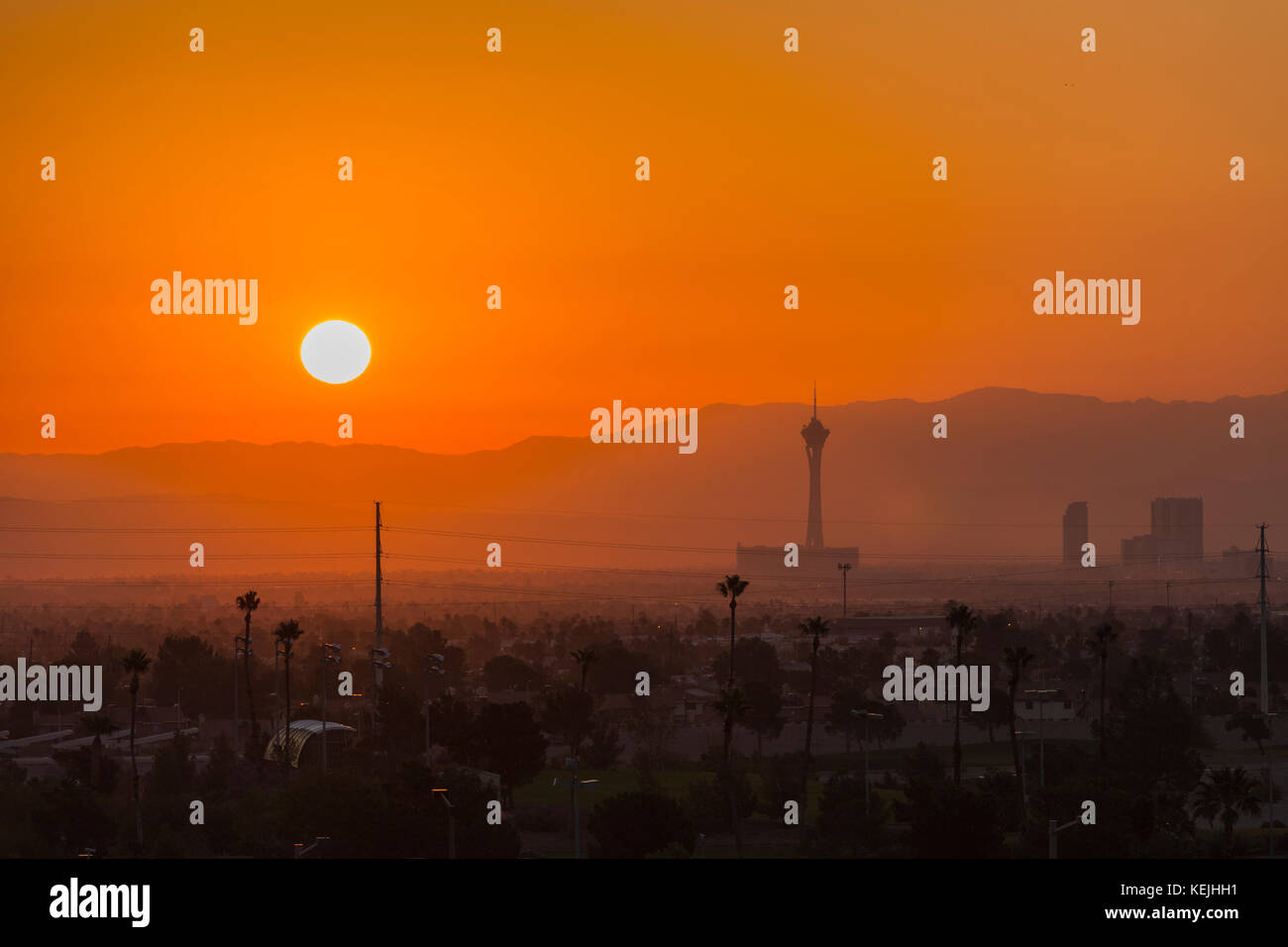 Las Vegas, Nevada, USA - October 13, 2017:  Hot Mojave desert sun rising behind the Stratosphere tower on the Las - Stock Image
