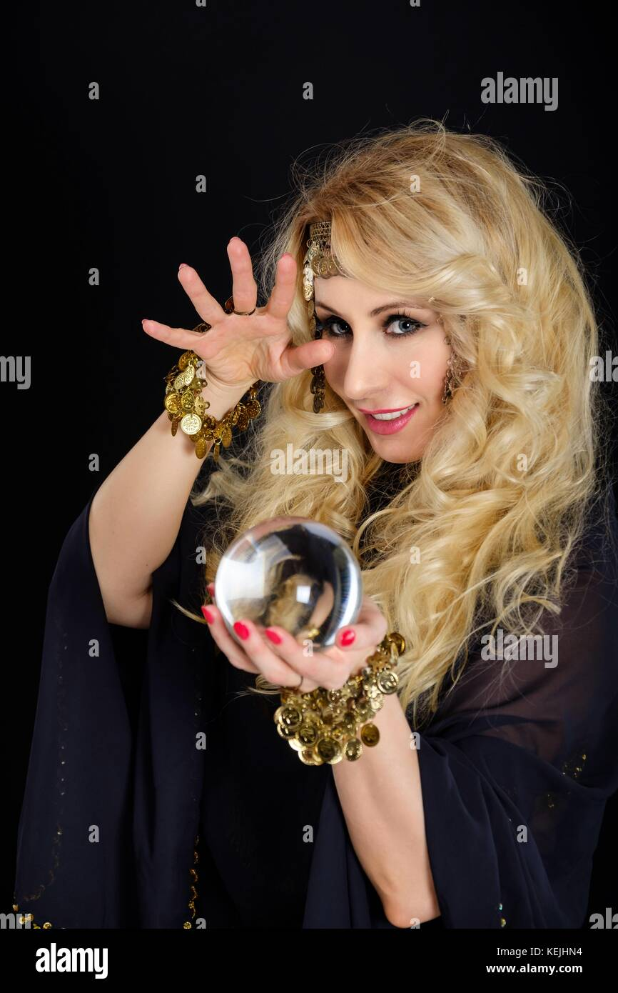 Woman fortune teller with crystal ball portrait - Stock Image