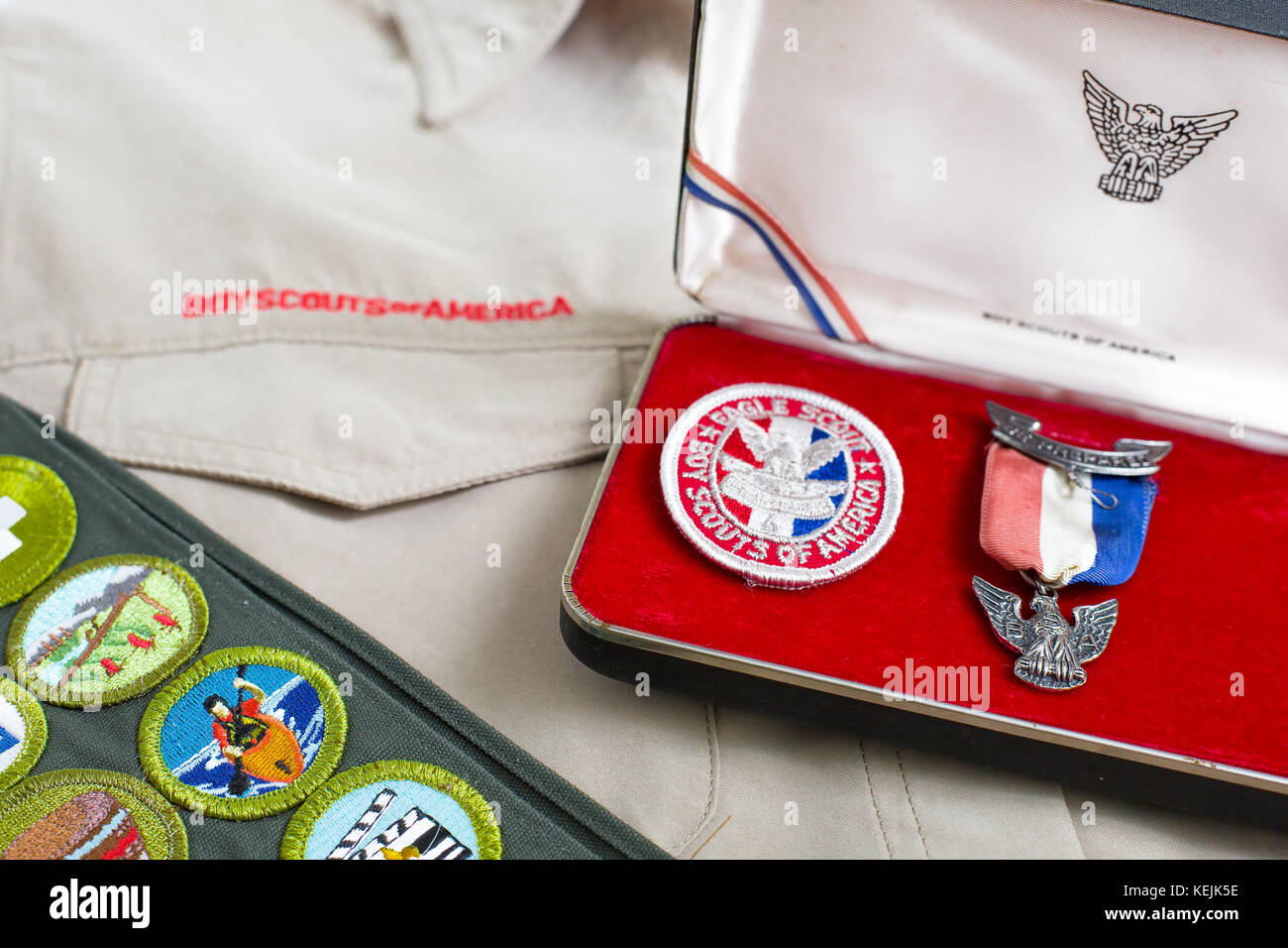 Boy scout eagle pin and patch with khaki uniform shirt and merit badge sash - Stock Image