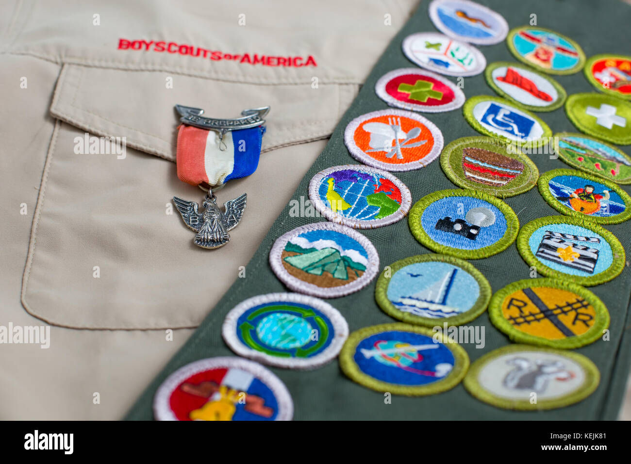 SAINT LOUIS, UNITED STATES - OCTOBER 16, 2017:  Eagle pin and merit badge sash on Boy Scouts of America (BSA) uniform - Stock Image