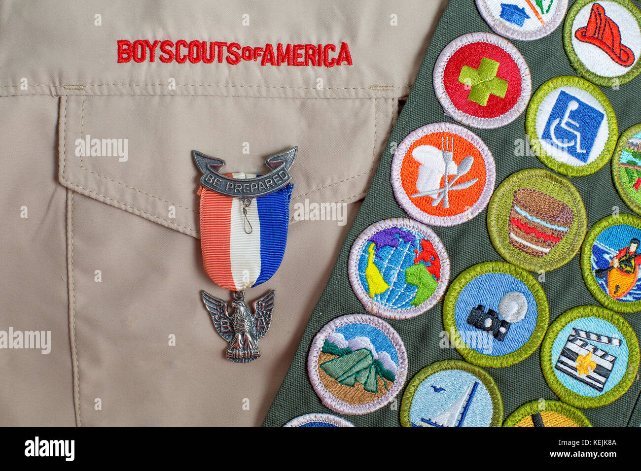 SAINT LOUIS, UNITED STATES - OCTOBER 16, 2017:  Eagle pin and merit badge sash on boy scouts of america uniform - Stock Image