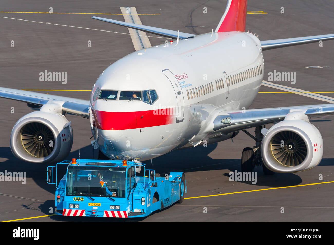 A Boeing 737 of Privatair being prepared for flight from Amsterdam's Schiphol Airport. - Stock Image