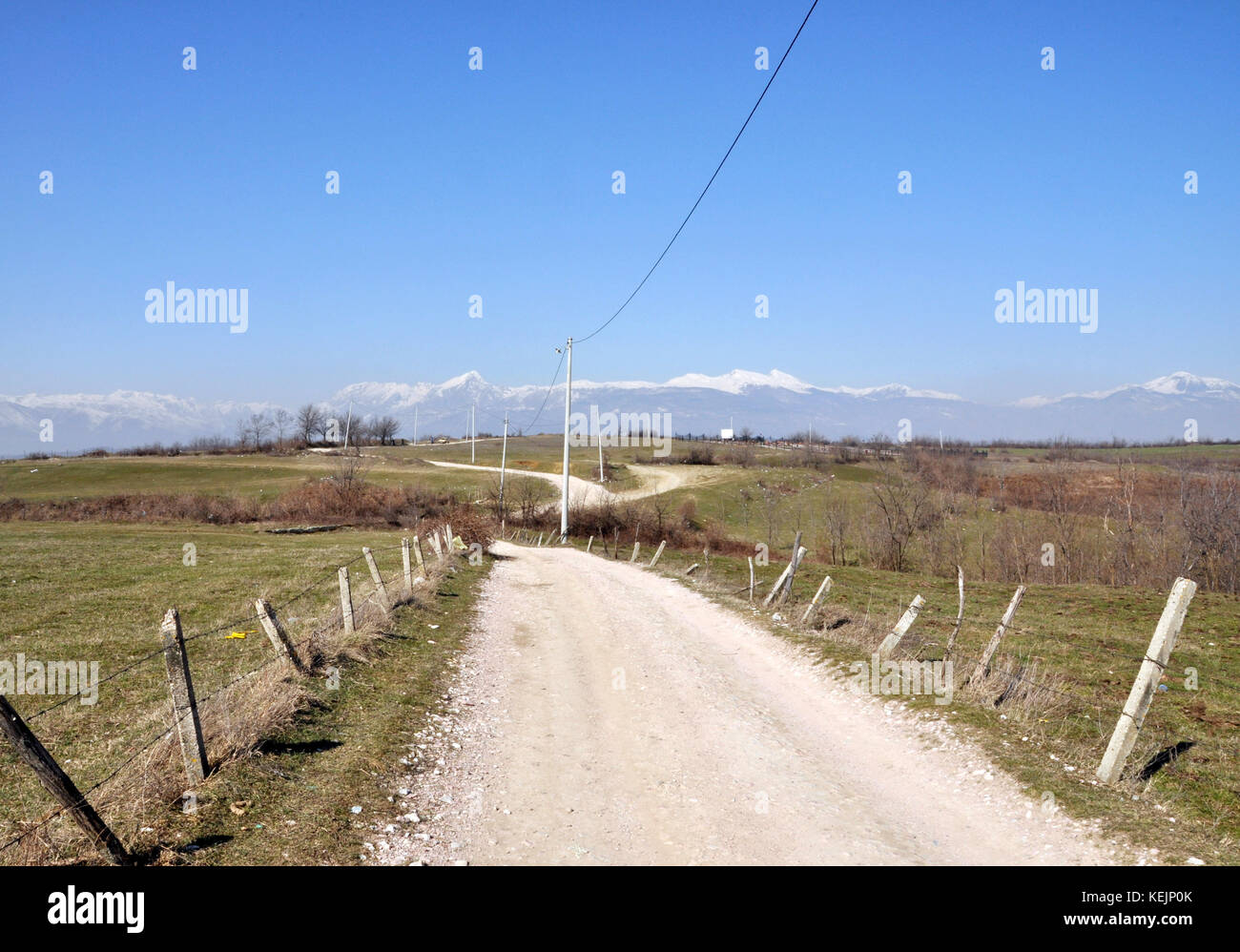 Gravel road in the hills of central Kosovo Stock Photo