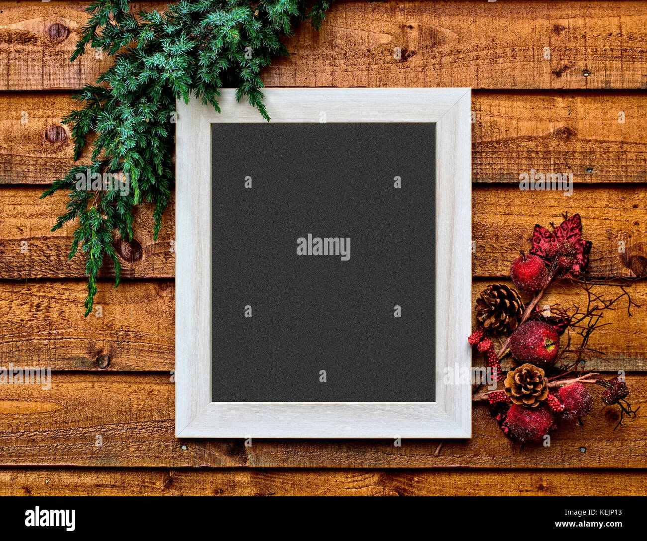 Christmas card photo, with space in the framed blackboard to write a personalised message - Stock Image