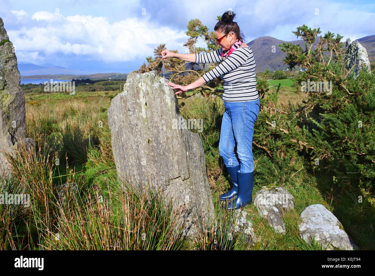 Female Pendulum Dowsing Ardgroom Stone Circle, County Cork, Ireland - John Gollop - Stock Image
