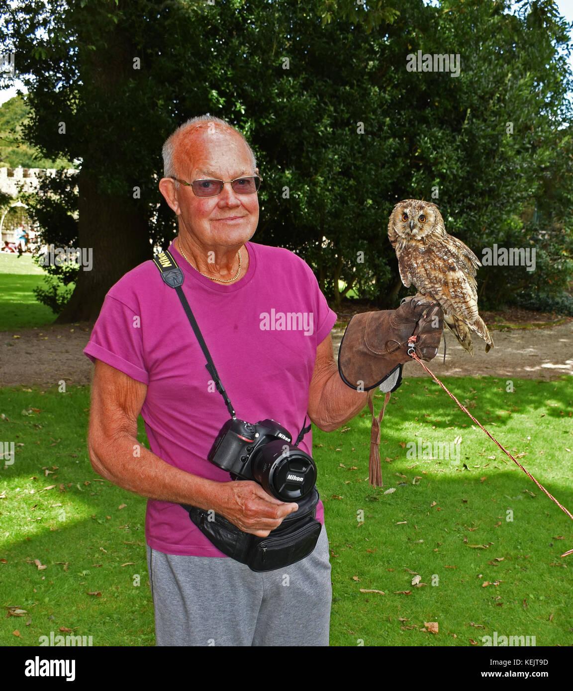 OAP holding long eared owl - Stock Image