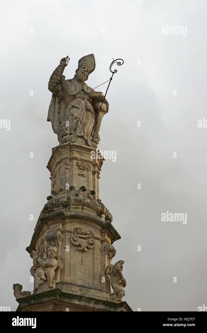 Sant'Oronzo Statue and obelisk in pazza della libertá, Ostuni, apulia, Italy - Stock Image