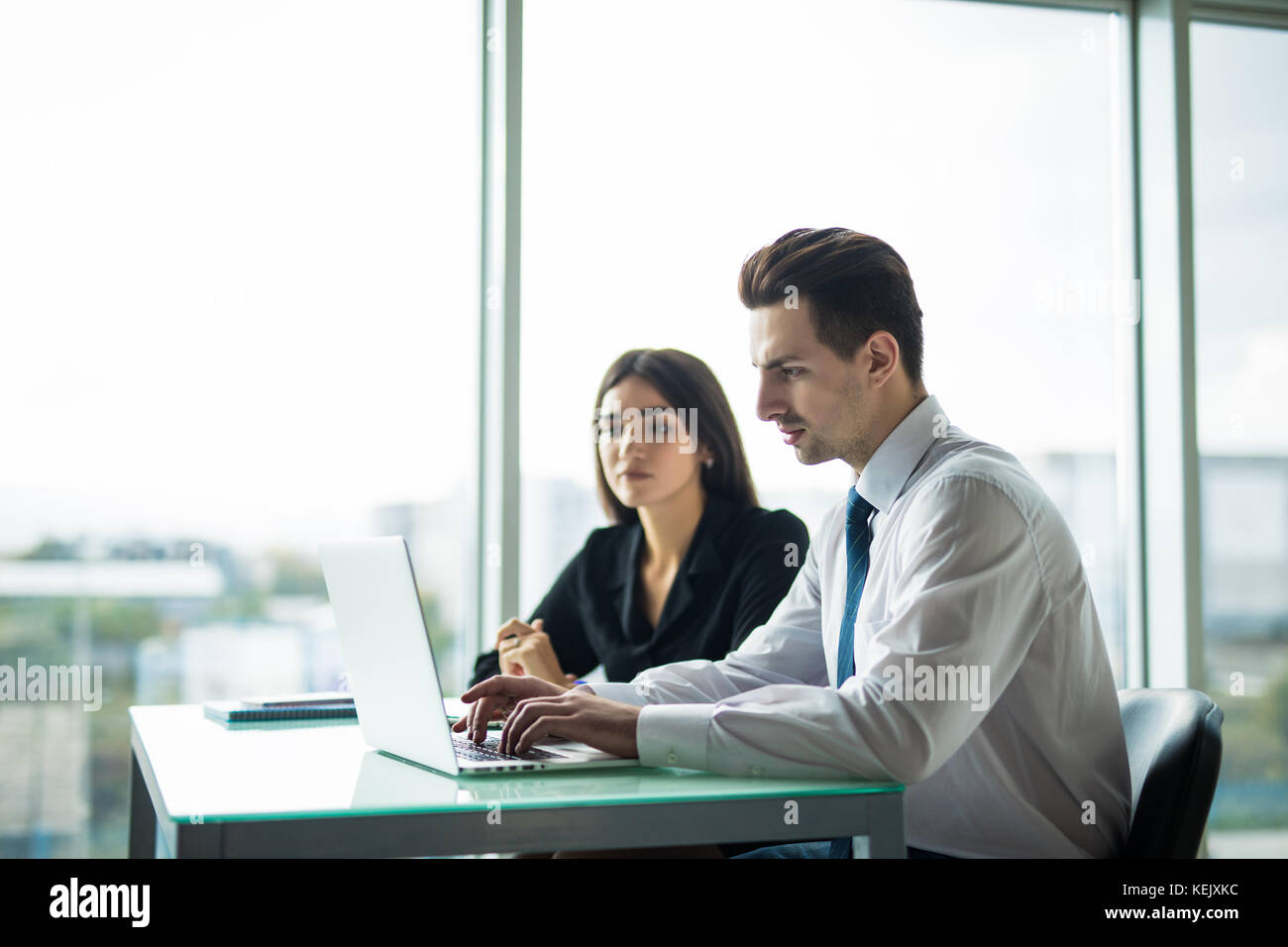 Business people Having Meeting Around Table In Modern Office - Stock Image