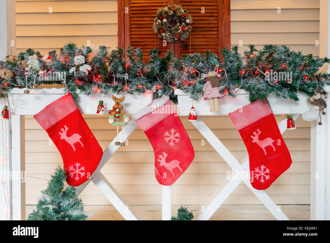 Christmas sock and decoration on wood. - Stock Image