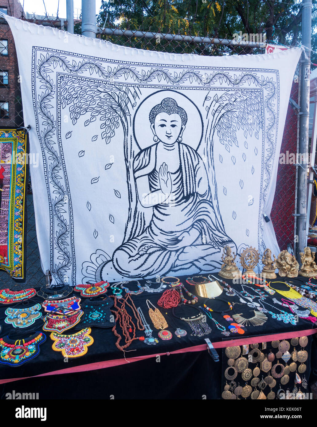 Indian Buddhism tourist items for sale at an outdoor mall in New York City - Stock Image
