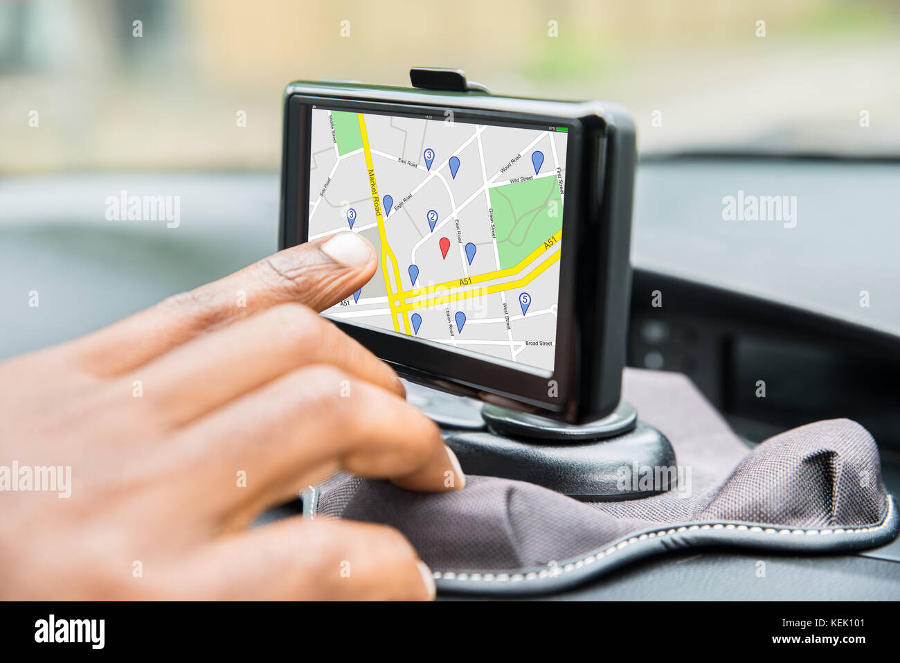 Close-up Of Person's Hand Using GPS Service While Driving Car - Stock Image