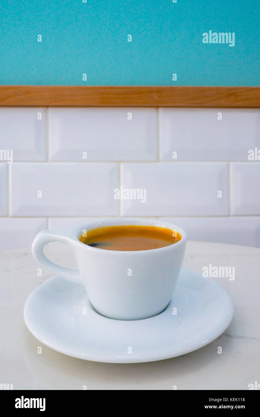 cup of americano coffee ready to serve on the marble table in the coffee shop in the morning. - Stock Image