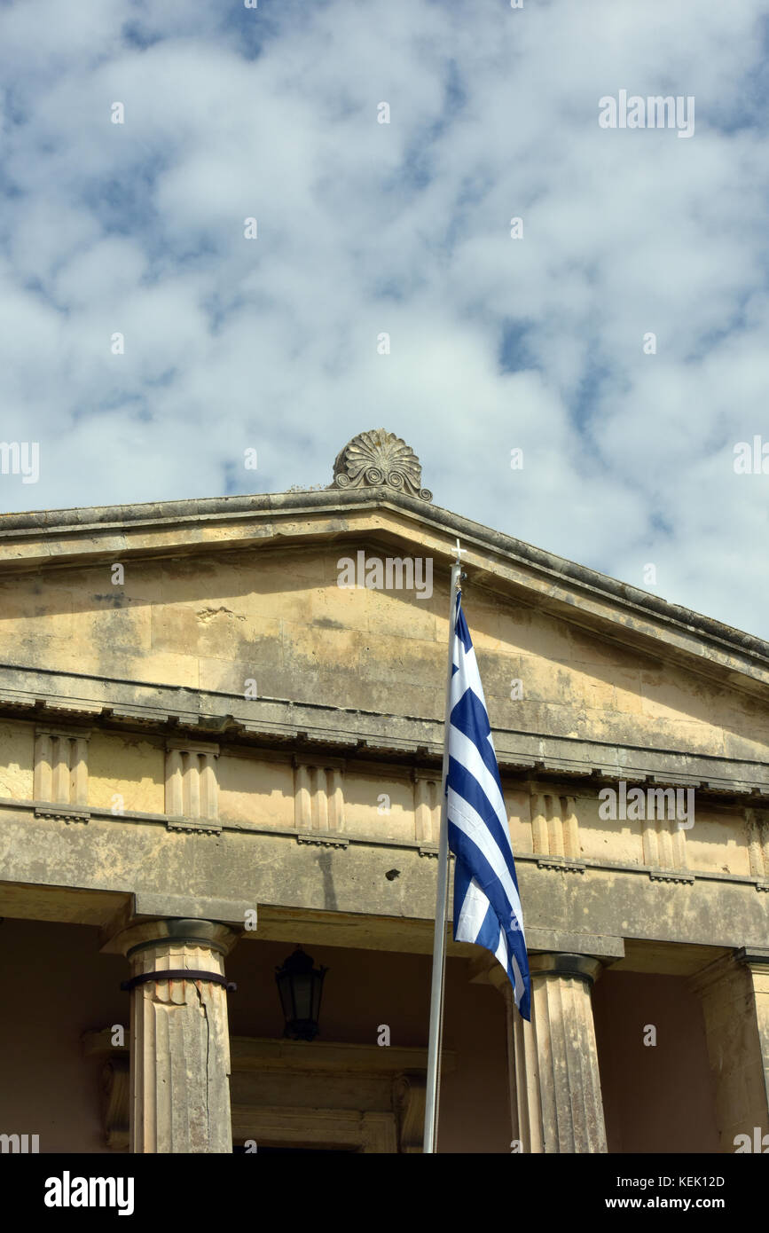 the national flag of Greece or greek emblems flying on a pole outside of a municipal or national building of importance - Stock Image