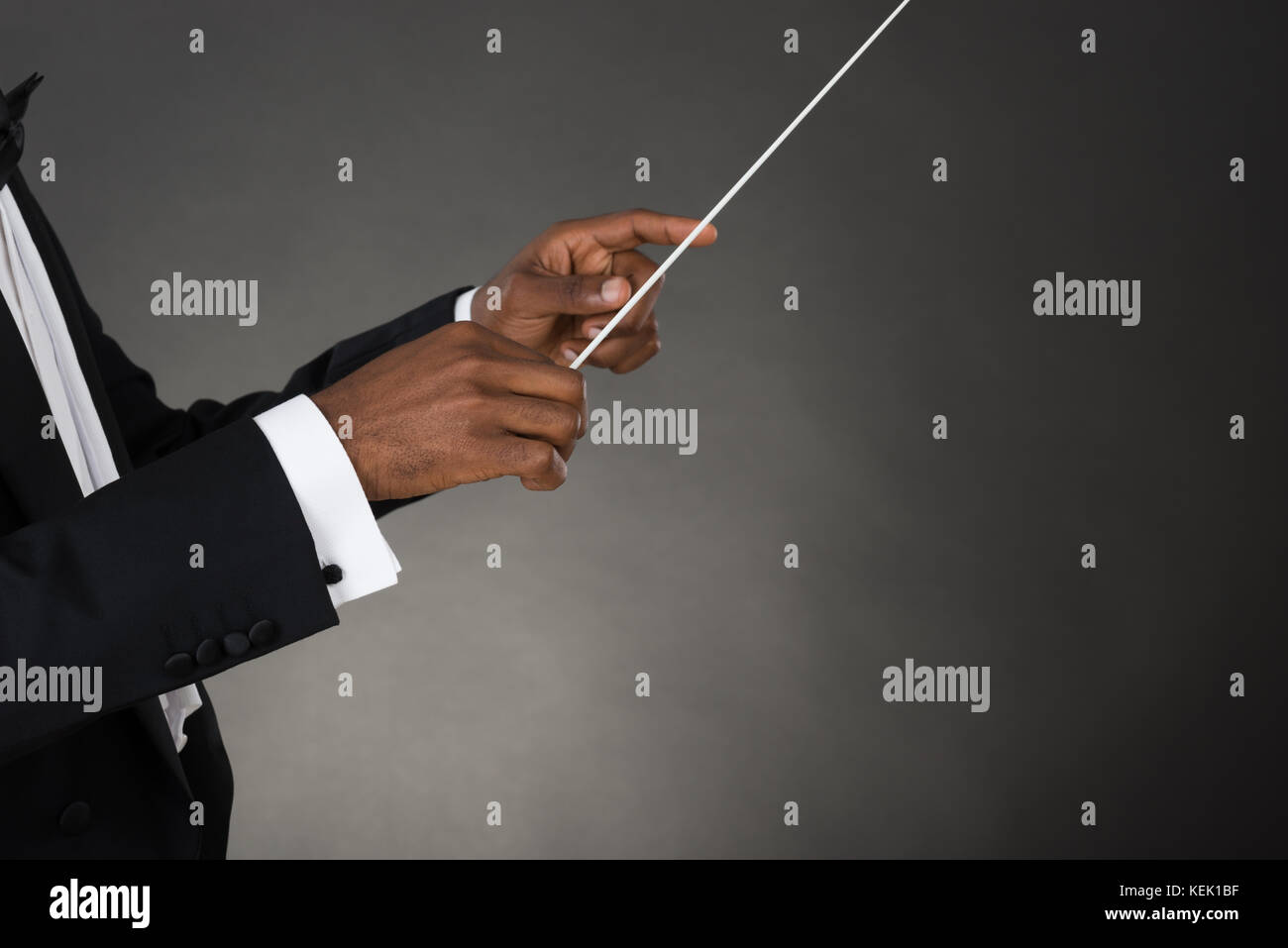 Close-up Of Music Conductor Hands Holding Baton - Stock Image