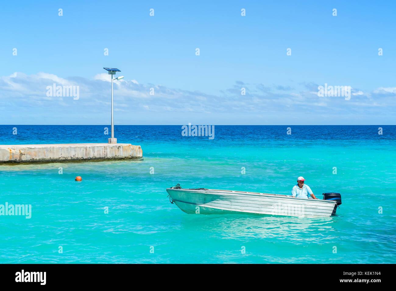 Small motorboat at sea in Rangiroa, French Polynesia - Stock Image