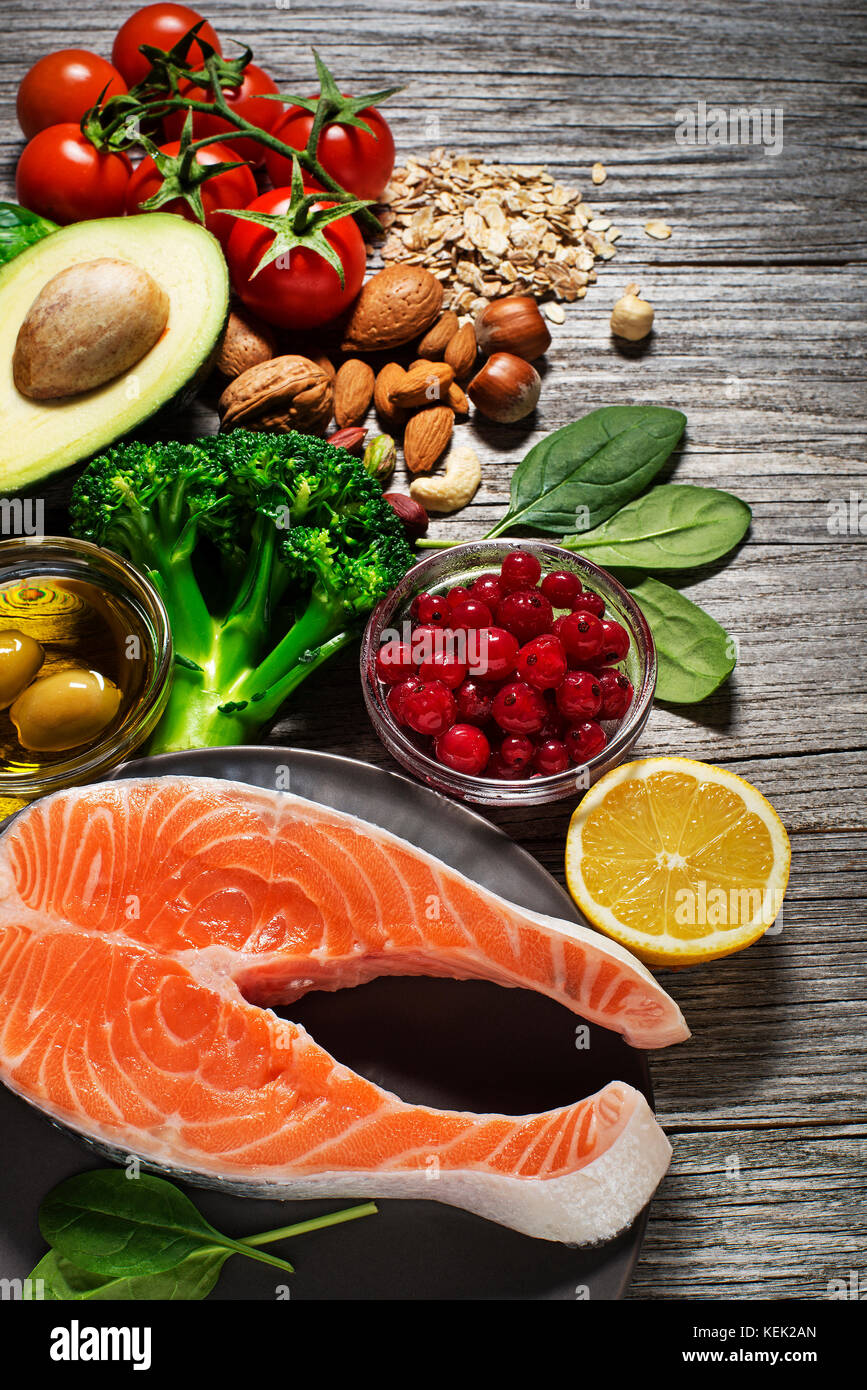 Mixed fresh healthy food with salmon fish- heart concept - Stock Image