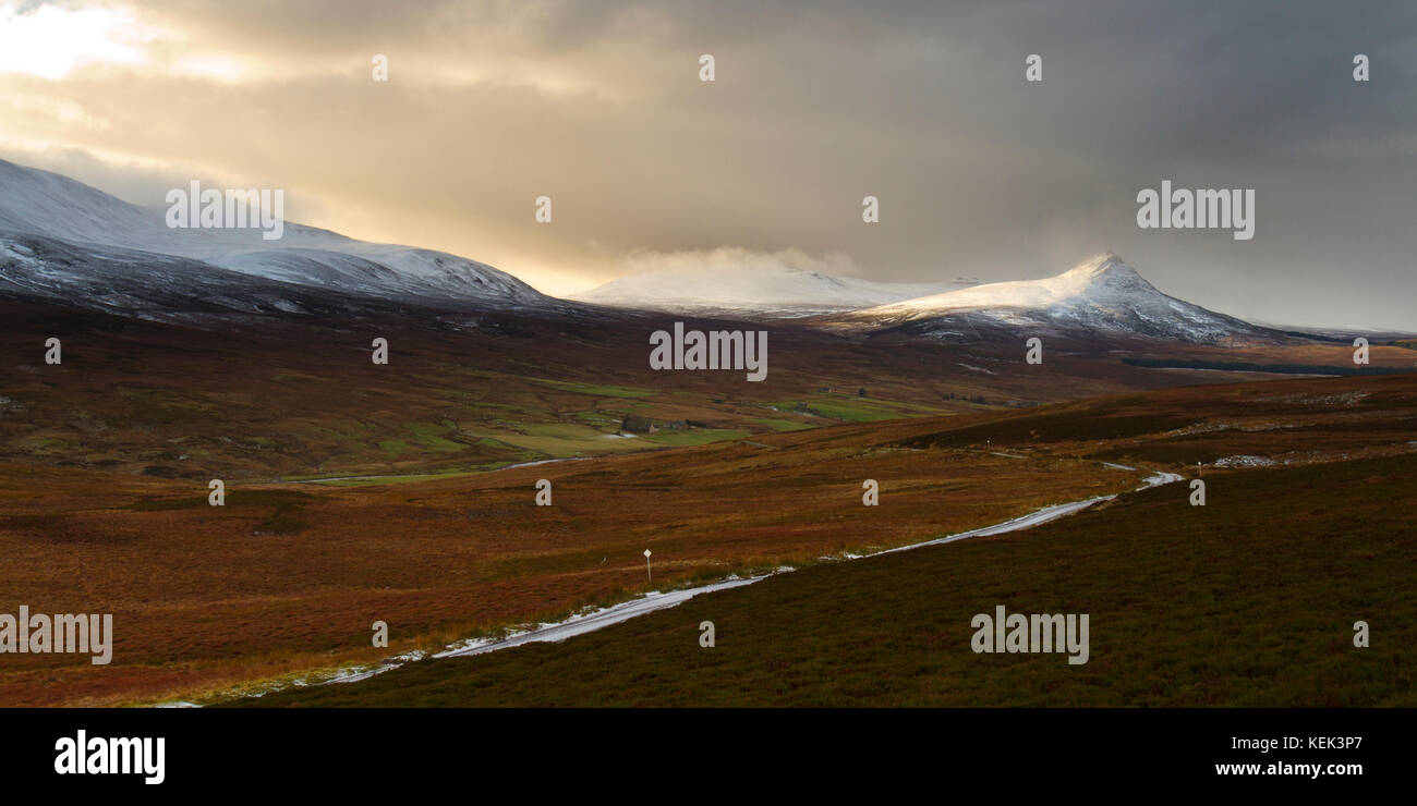 Snow capped Scaraben and Maiden Pap sit above the Berriedale valley in Caithness - Stock Image