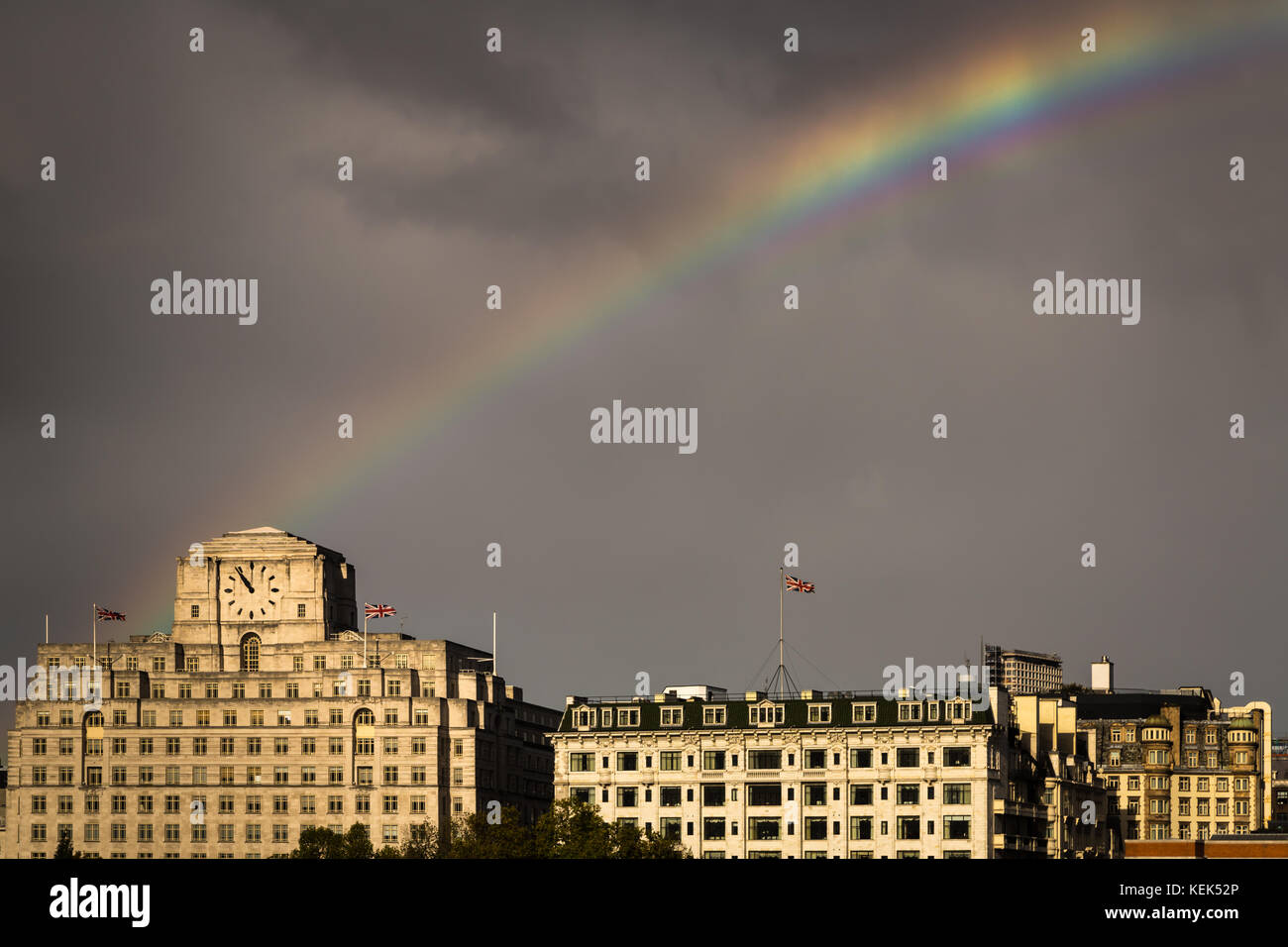 London, UK. 21st Oct, 2017. UK Weather: Storm Brian brings a breaking rainbow over Shell Mex House and Savoy Hotel - Stock Image