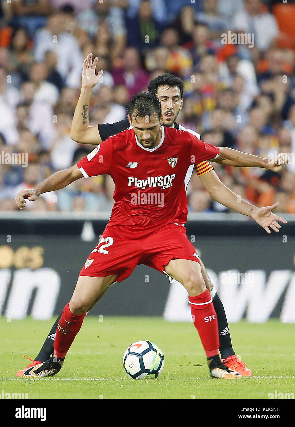 Sevilla CD´s player Franco Damian and Valencia´s Dani Parejo (behind) the Primera Division LaLiga match - Stock Image