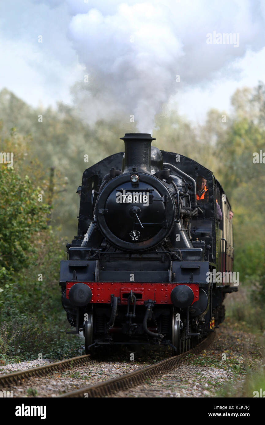 Peterborough, UK. 21st Oct, 2017. A steam locomotive train 78018 powers its way through Nene Park in Peterborough Stock Photo