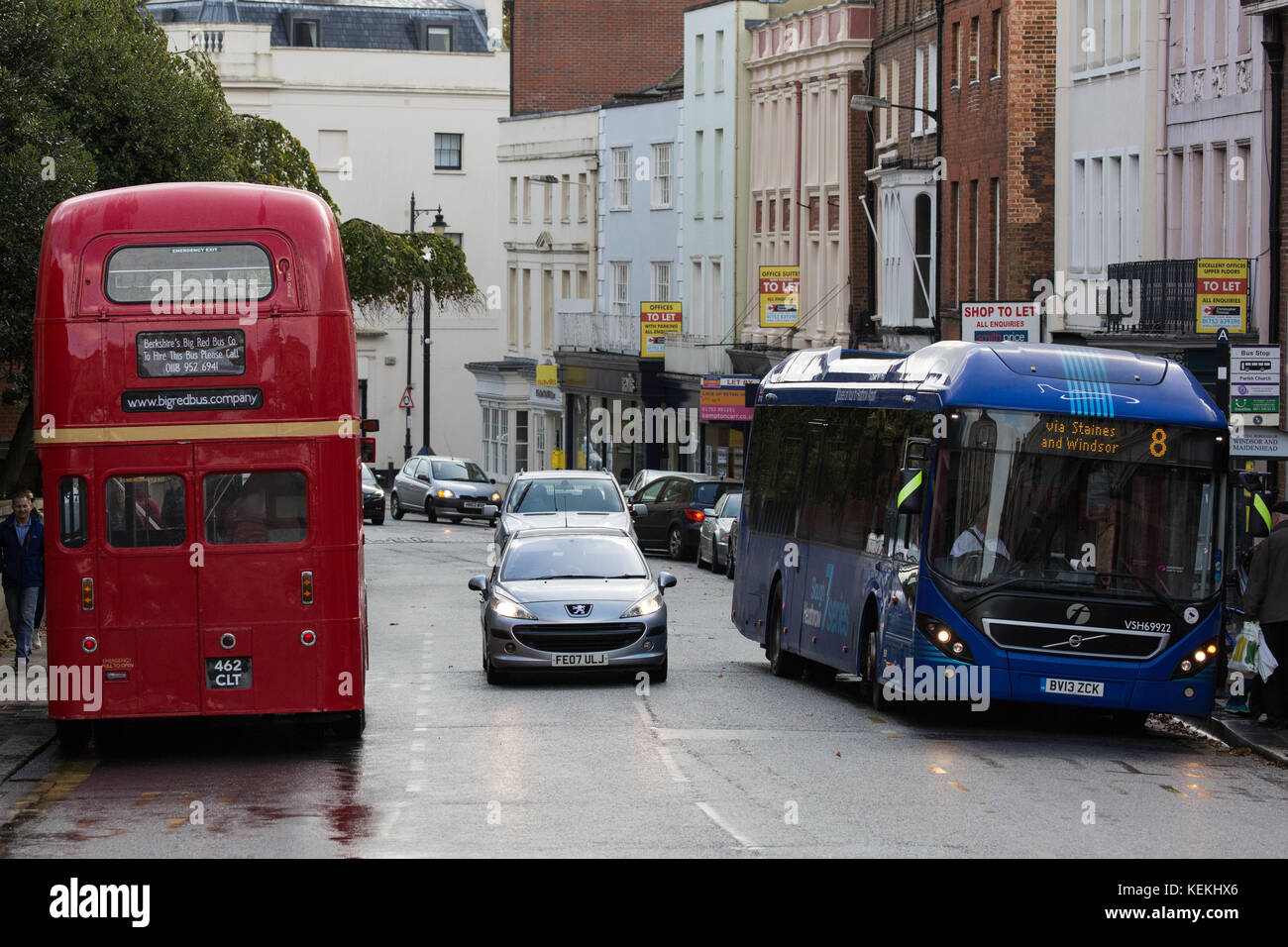Windsor, UK. 21st October, 2017. An old double-decker and a contemporary single-decker bus in Windsor High Street. - Stock Image