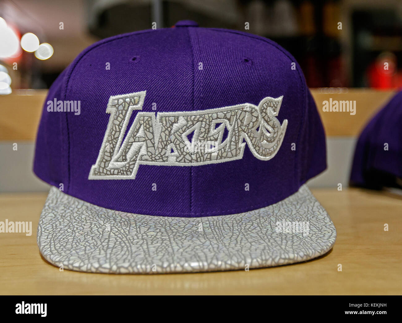 5332889badf Los Angeles Lakers hat on sale in the NBA store in Manhattan. - Stock Image