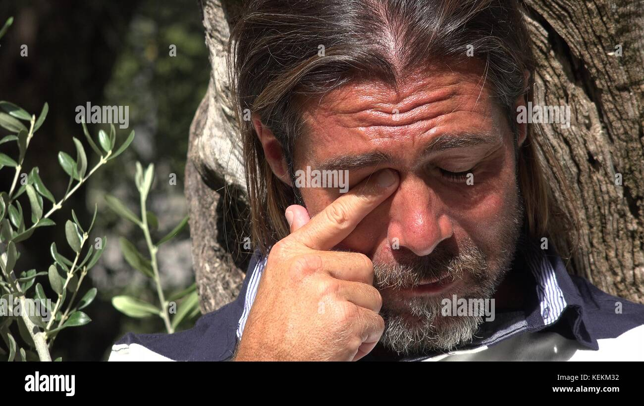 Tearful Handsome Male - Stock Image