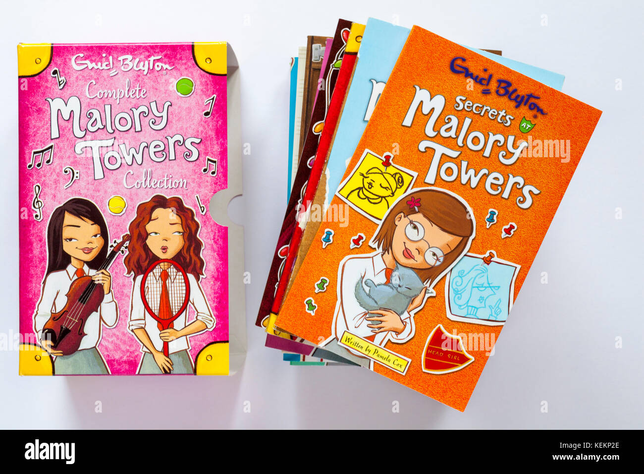 Complete Malory Towers Collection books by Enid Blyton - books piled with Secrets of Malory Towers book on top isolated - Stock Image