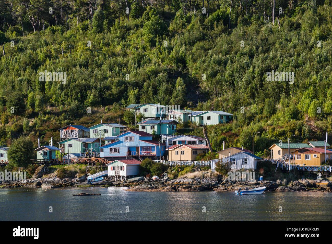 Village of Puerto Gaviota over Canal Puyuhuapi, Valdivian temperate rainforest, at Isla Magdalena, Aysen Region, - Stock Image
