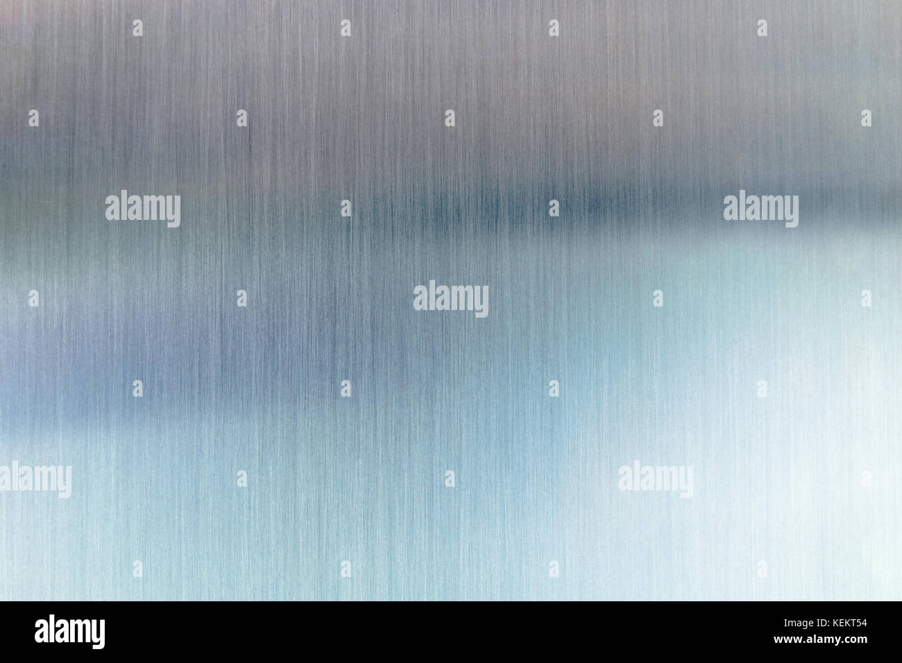 Convex polished shiny steel metal surface with colored reflections and glare. - Stock Image