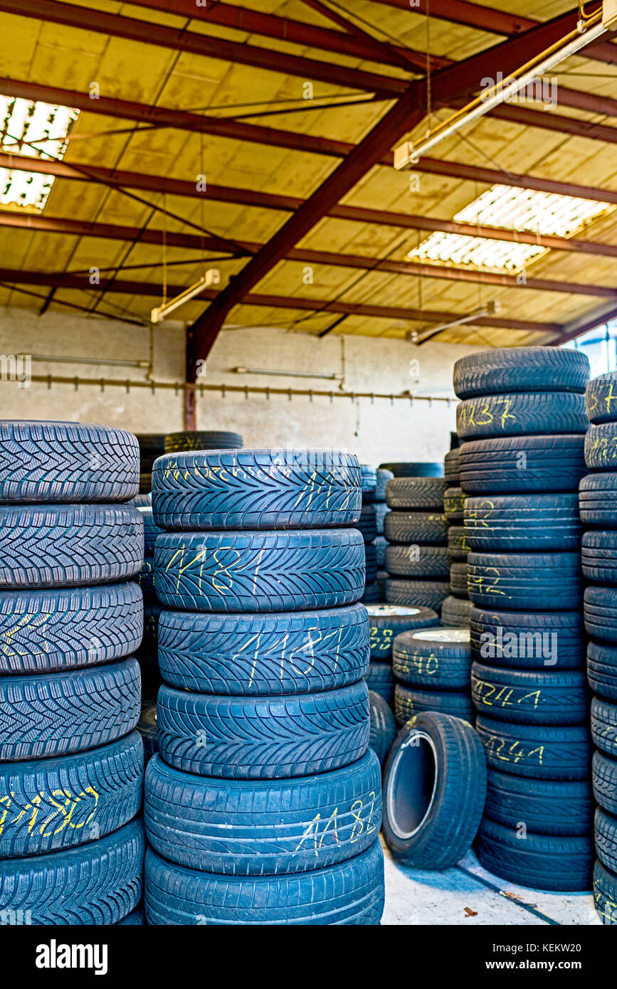 Pile of old Tyres in a shop - Stock Image