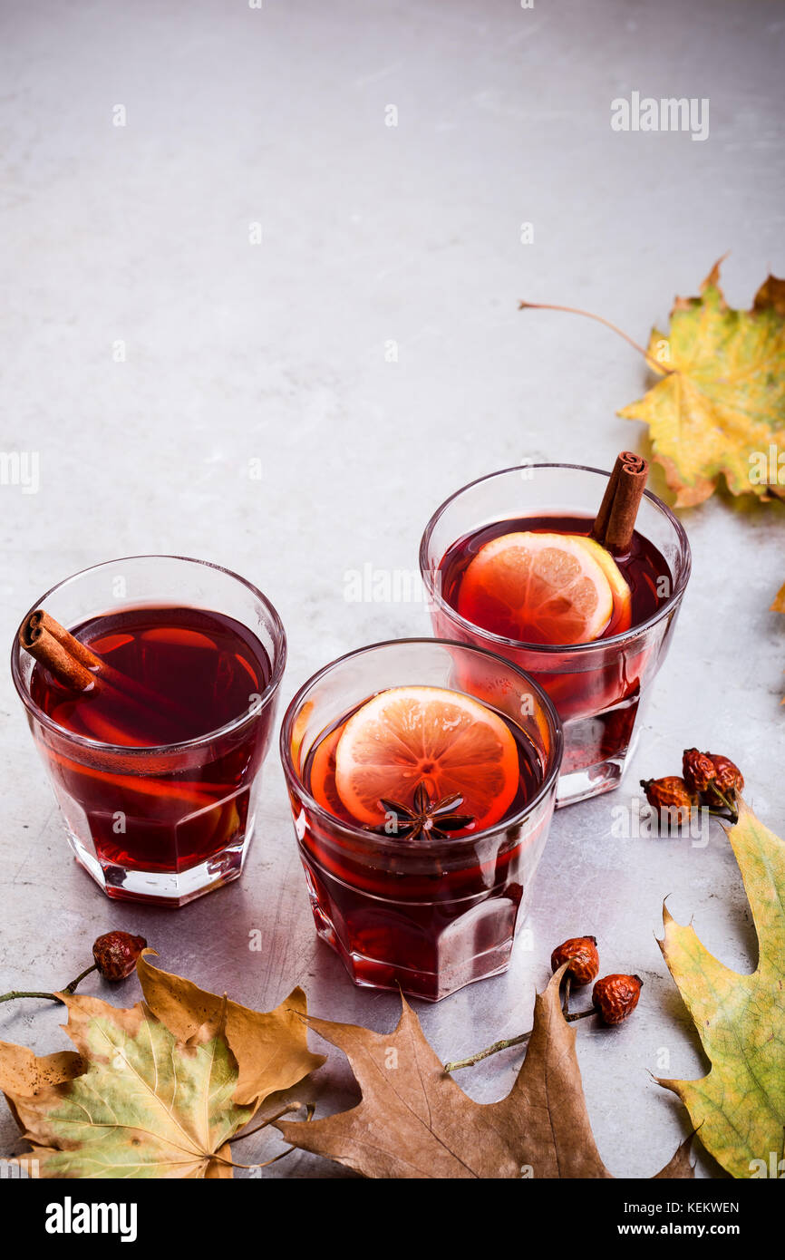 Hot red tea with lemon on light gray table with copy space, delicious autumn mulled wine drink Stock Photo