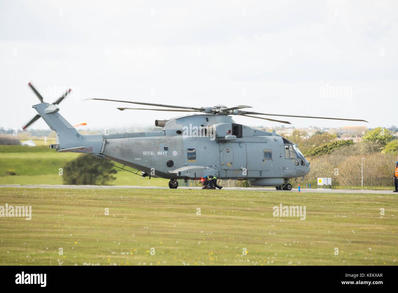 Fleet Air Arm Agusta Westland Merlin HM1 helicopter ground running RNAS Culdrose groung crew man removing chocks - Stock Image