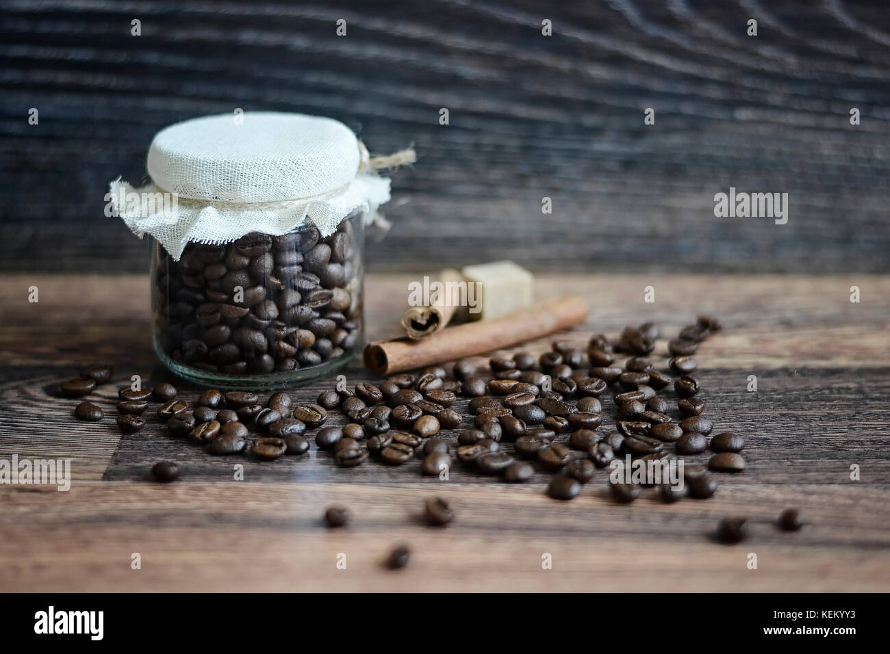 Coffee beans on a wooden table - Stock Image