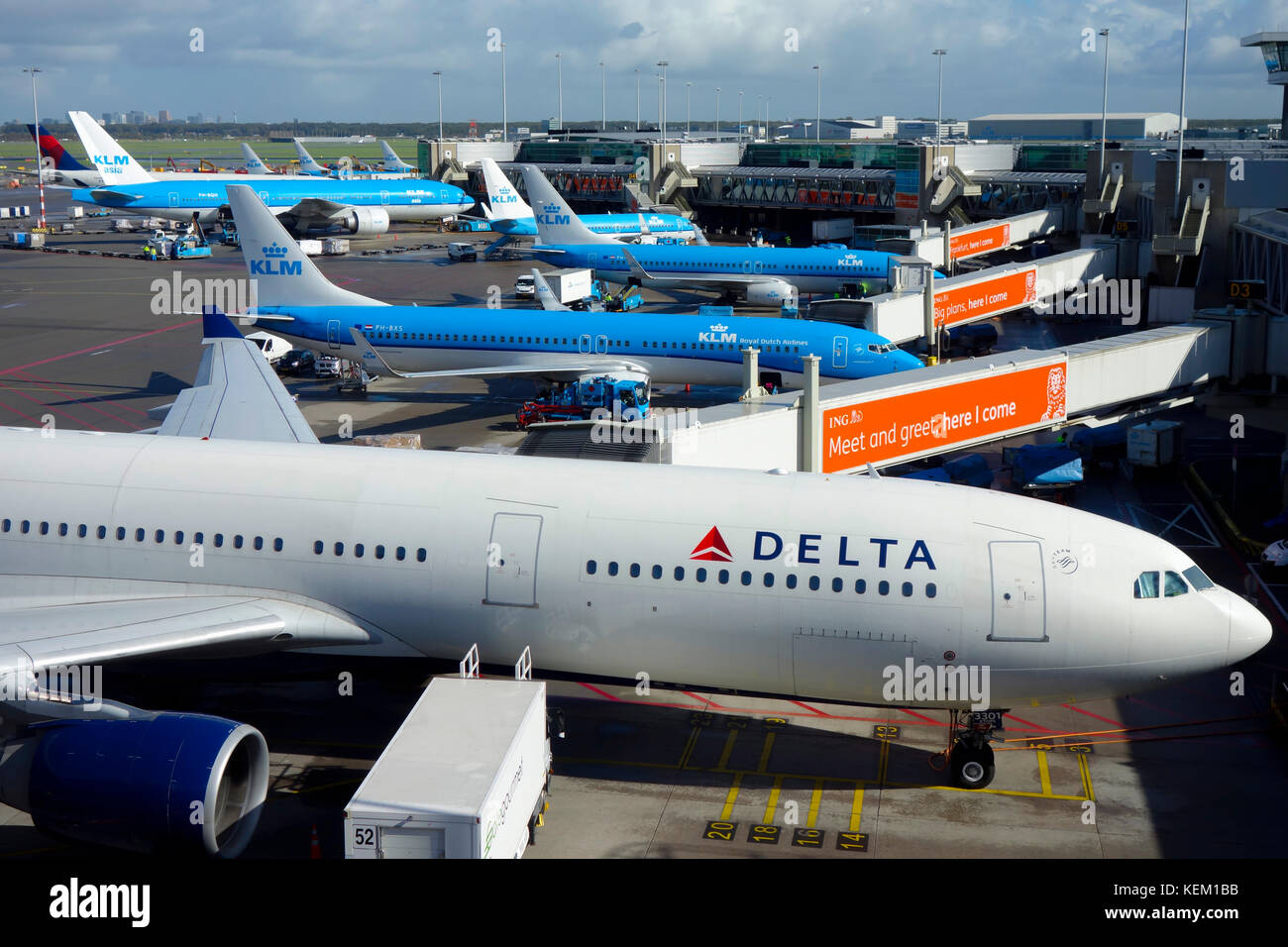 Delta and KLM aircraft on the runway awaiting departure at Amsterdam Schiphol Airport. - Stock Image