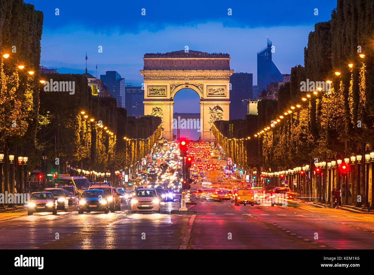 Avenue des Champs Elysees and Arc de Triomphe at night, Paris - Stock Image