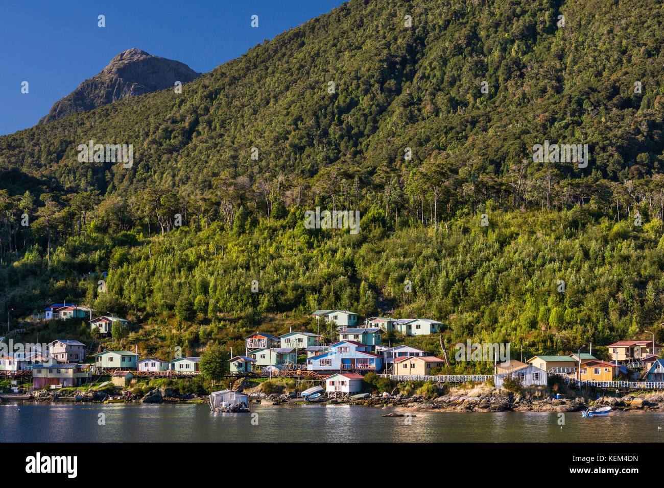 Village of Puerto Gaviota over Canal Puyuhuapi, Valdivian temperate rainforest, at Isla Magdalena, Aysen Region, - Stock Image