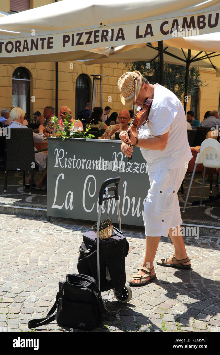 Musician playing in Malcesine, on Lake Garda, in the Lombardy region, in north Italy Stock Photo