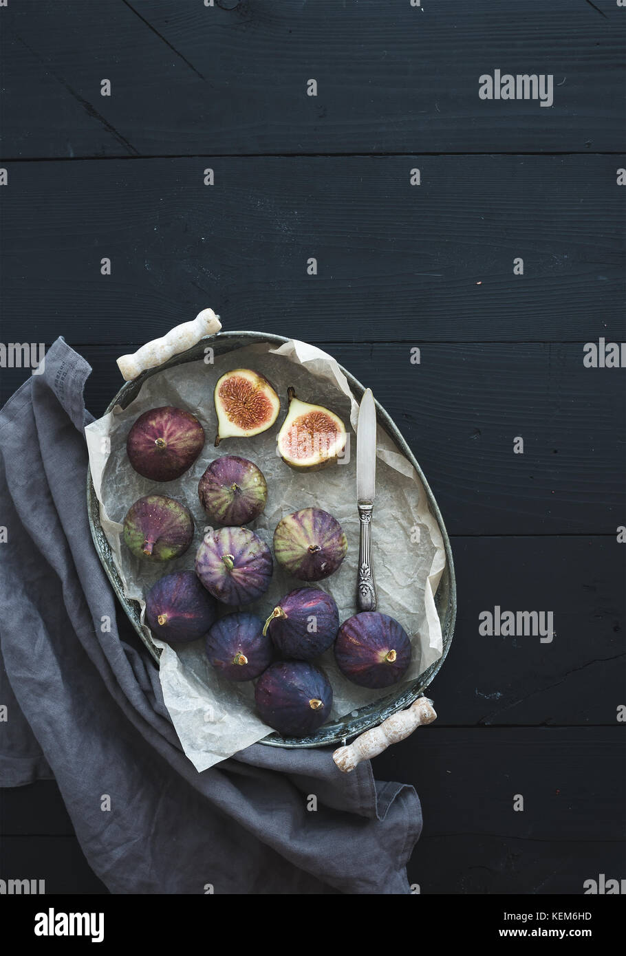 Vintage metal tray of fresh figs on dark background, top view, selective focus. - Stock Image
