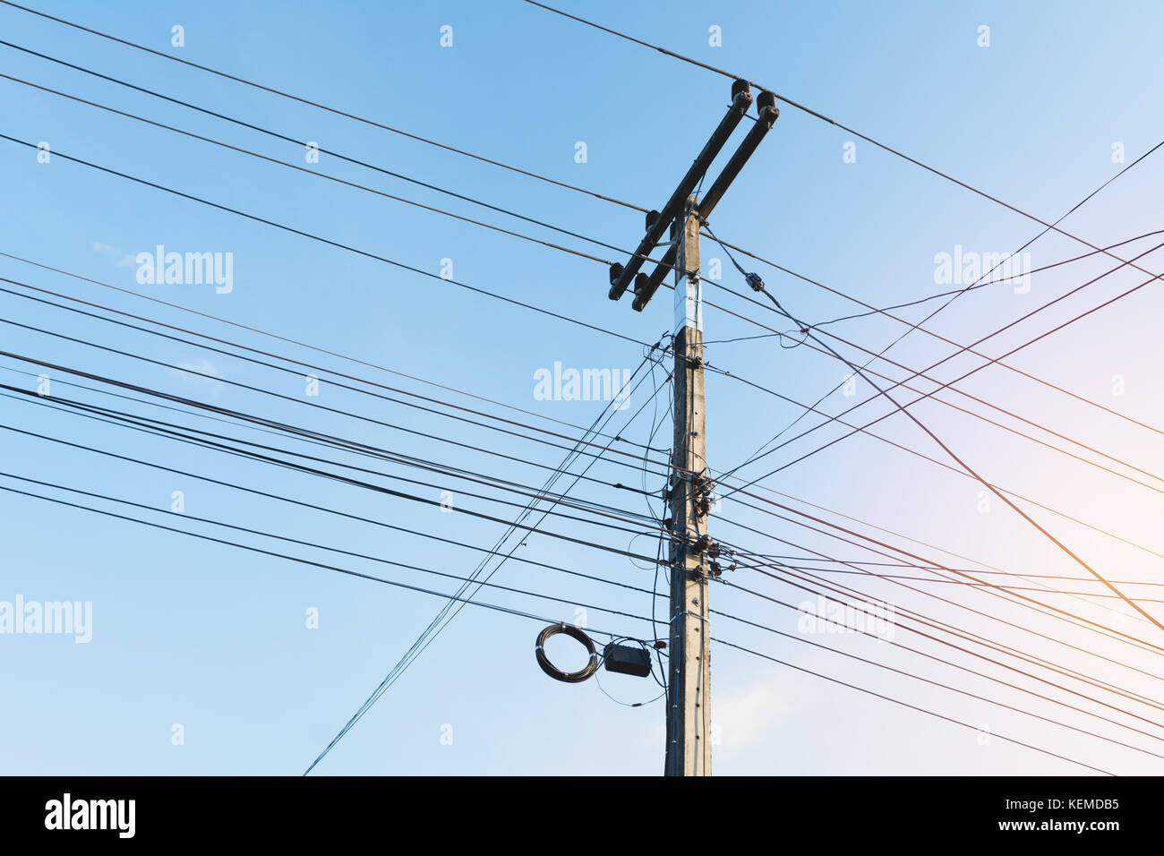 The electric pole with black wire cable and clear blue sky. Concrete ...
