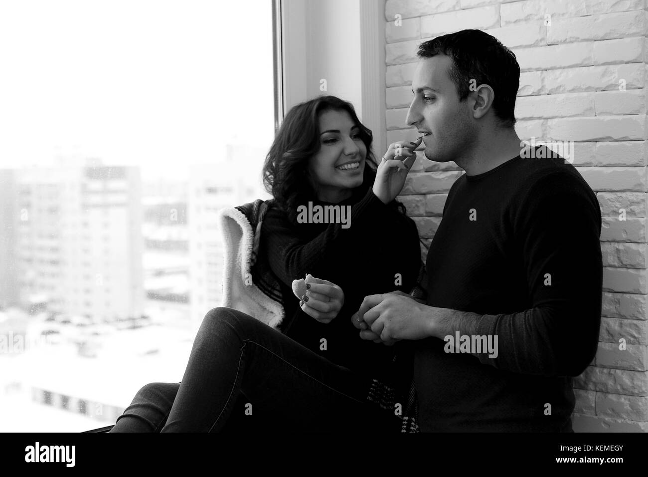 Couple in front of a window - Stock Image