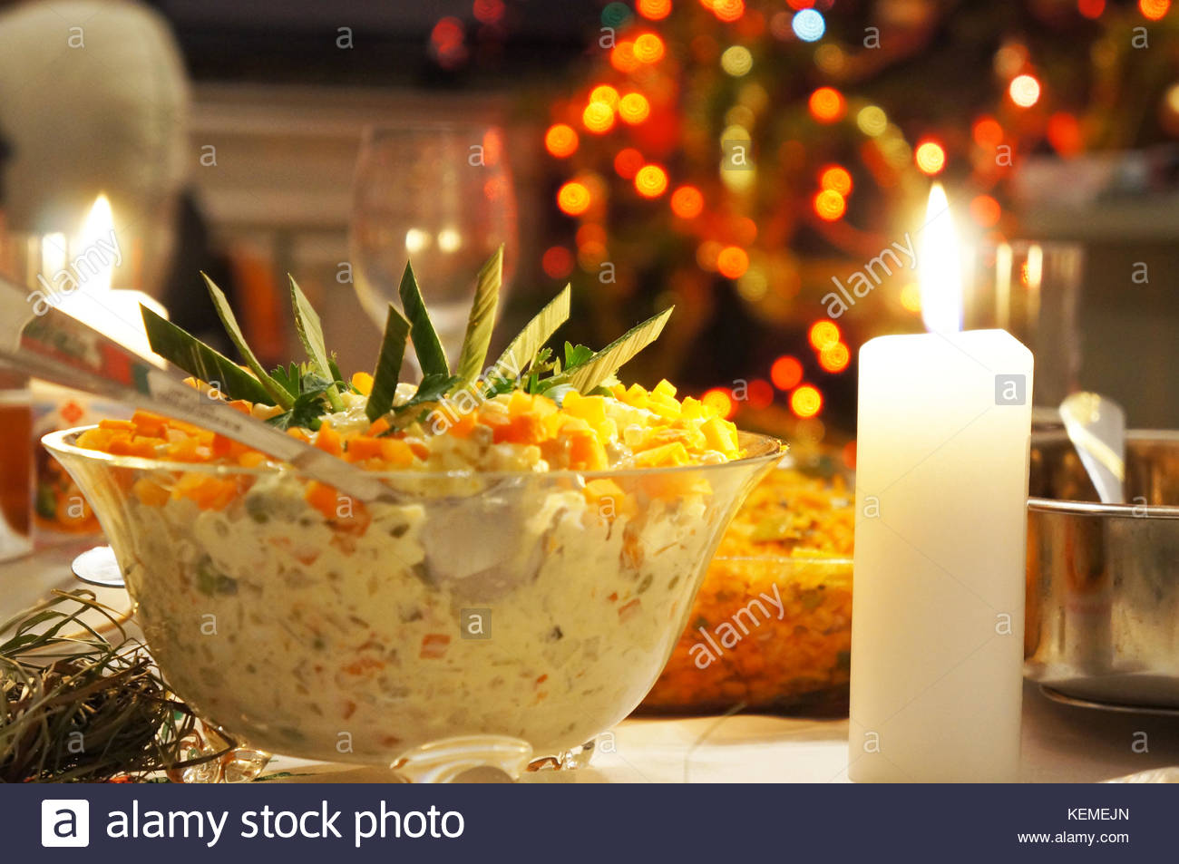 A Polish Christmas salad served in a bowl on a evening - Stock Image