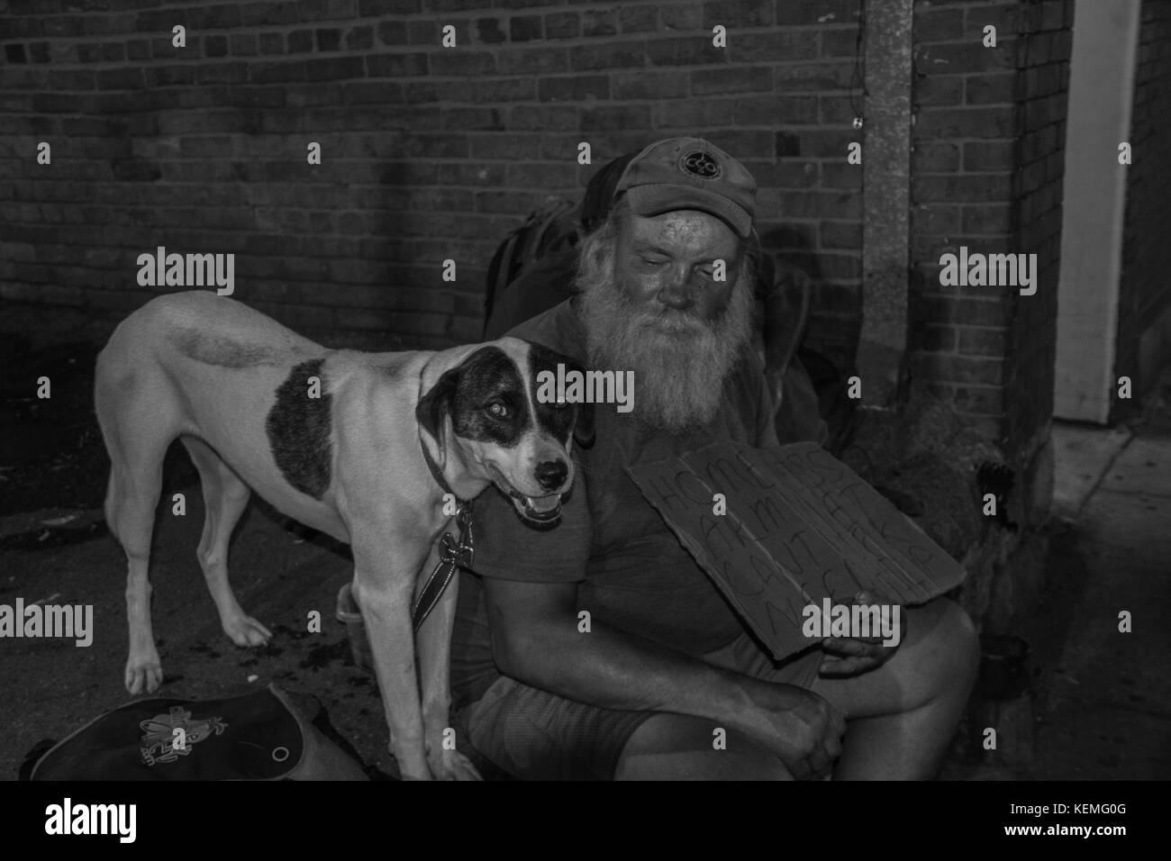 Homeless man and his dog Stock Photo