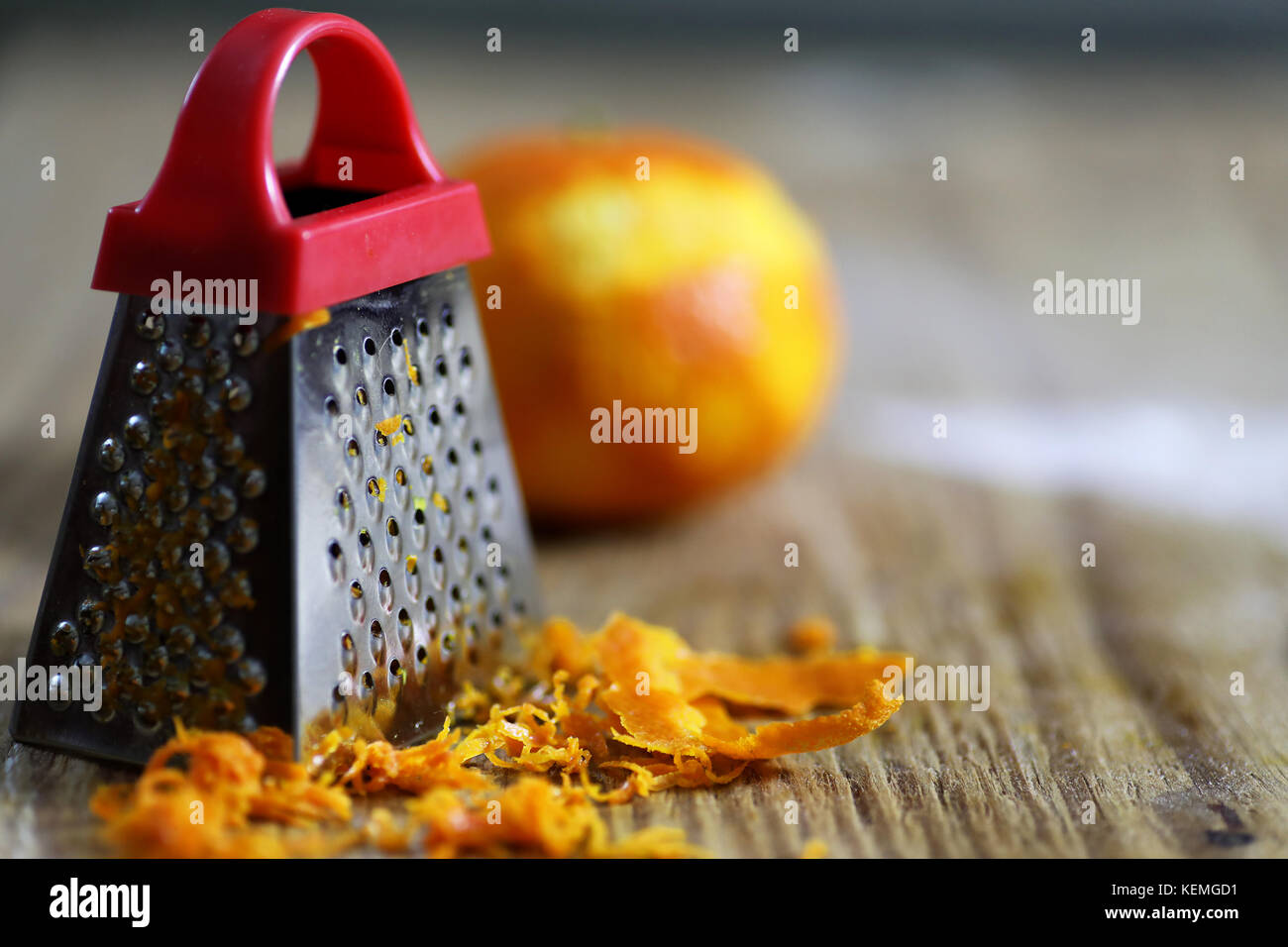 grater zest of citrus fruit and on wooden table - Stock Image