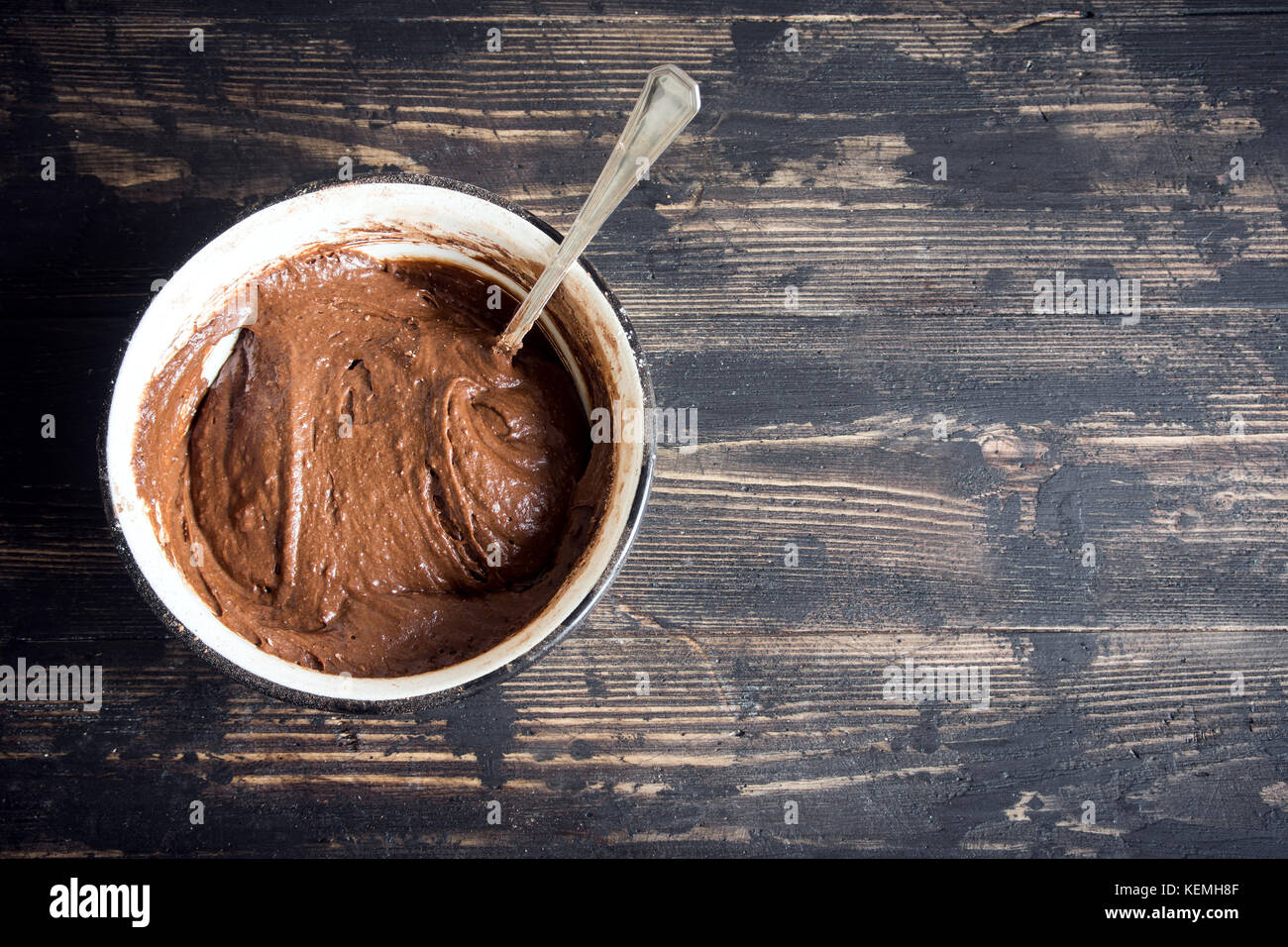 Basic homemade brownie or chocolate cake raw dough in bowl. Cooking (baking) homemade chocolate cake or brownie. Stock Photo