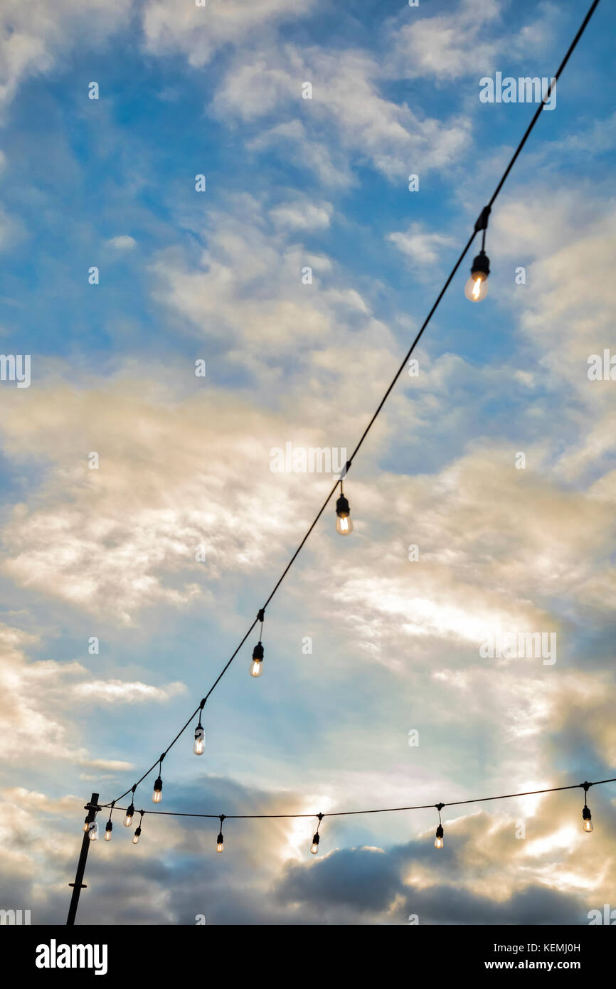 Outdoor string lights at sunset in San Diego, California - Stock Image