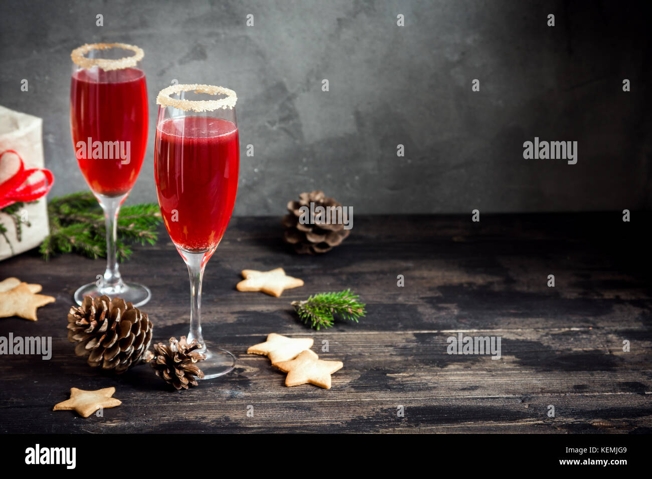 Mimosa festive drink for Christmas - champagne red cocktail Mimosa with cranberry for Christmas party, copy space - Stock Image
