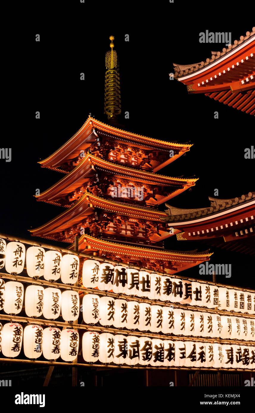 Senso-ji Buddhist temple old pagoda at night with traditional japanese lanterns in Asakusa, Tokyo - Stock Image