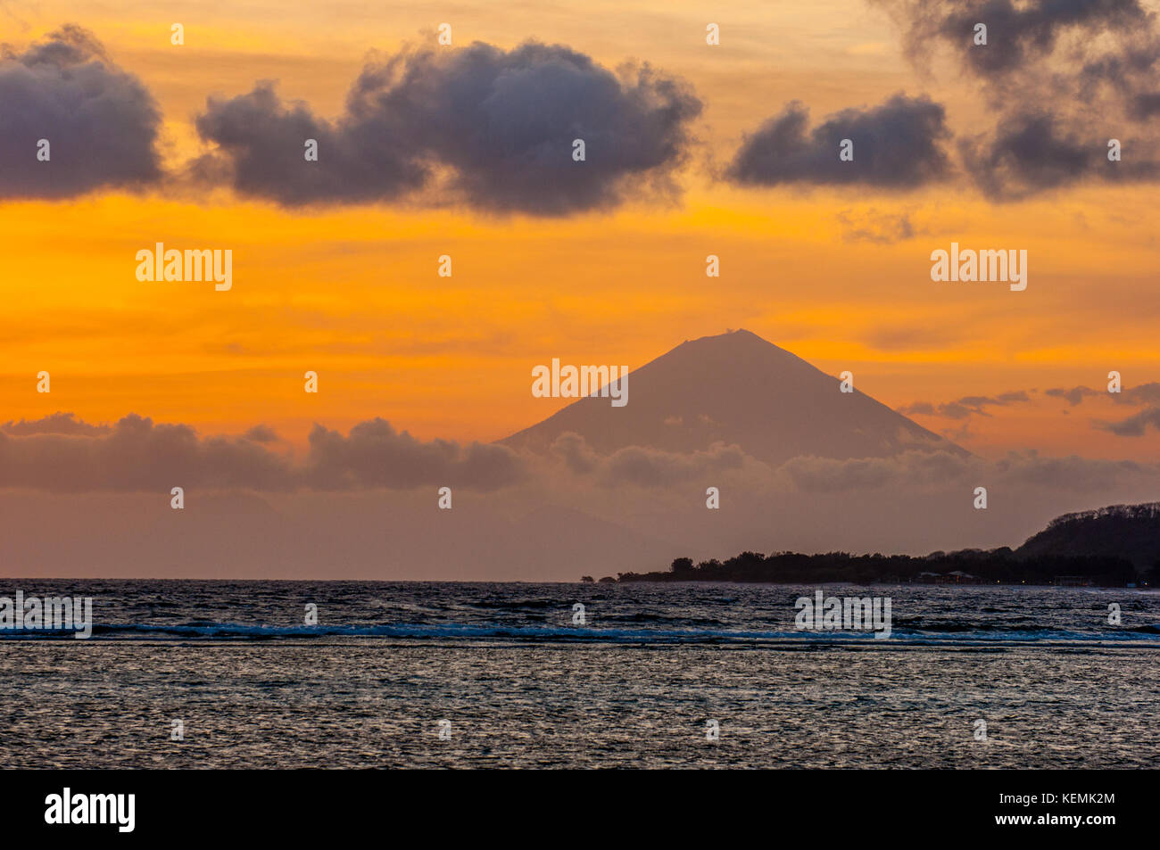 View of Agung from Gili Air Island at sunset. Lombok, Indonesia - Stock Image